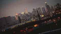NYC skyline with Subway cars by night Stock Footage