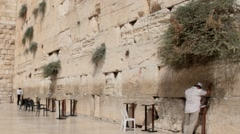 Unidentified jewish worshipers  near the Western Wall an important jewish site Stock Footage