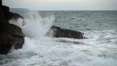Storm waves crashing into rocky shore, slow motion Stock Footage