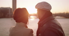 Attractive young couple at Millennium bridge watching the sunset over London Stock Footage