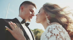 Bride and groom  kissing close up sunshine - stock footage