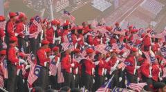 Red uniformed flag show,Kuala Lumpur,Malaysia - stock footage