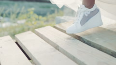 Bride in white running shoe pier. Trainers from close slowed Stock Footage