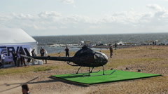 Helicopter take off from beach. Slow motion Arkistovideo
