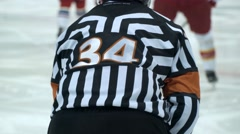 Stock Video Footage of Hockey referee hold a puck