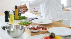 Closeup of dish being prepared by cook - stock footage