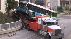 Spectacular transit bus crash after accident with truck on city street Stock Footage