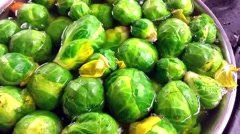 Boiling brussels sprouts, in a caserol, at a restaurant kitchen - stock footage