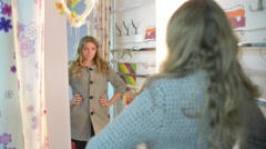 Woman model looks to the mirror - fashion dress Stock Footage
