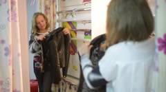 Little girl model looks to the mirror - fashion dress Stock Footage