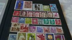 Album with an old post stamps - stock footage