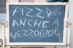 "Menu of a restaurant  where there is' wrote: ""Pizza also lunch"" Stock Photos"