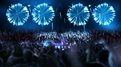 Crowd of people and fireworks explosions (still cam blue) Stock Footage