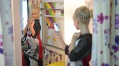 Little Girl Make Selfie In Front Of Mirror Via Smart Phone Camera Stock Footage