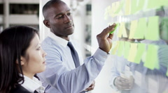 4K Attractive business man and woman brainstorming for ideas with sticky notes - stock footage
