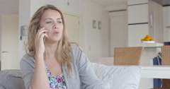 Young woman having a long telephone conversation  Stock Footage