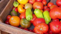 Tomatoes and peppers in a wooden box. Stock Footage