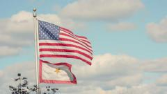 Slow Motion Two Flags Blowing in Wind Stock Footage