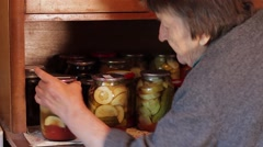 Grandmother puts preservation on the shelf. Stock Footage