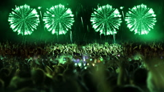 Crowd of people and fireworks explosions (still cam green) Stock Footage
