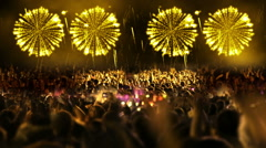 Crowd of people and fireworks explosions (still cam yellow) Stock Footage