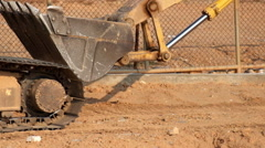 Excavator driving on a dusty road. Bucket close up. Video with original audio Stock Footage