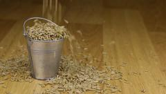 Fall into a bucket of rye grains and on wooden floor Stock Footage