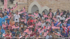 Crowds on grandstand waving flag slowly,Kuala Lumpur,Malaysia Stock Footage