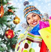 Beautiful shopping Christmas woman with bags. Kuvituskuvat