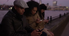 Friends glued to their smartphones. Shot on RED Epic. Stock Footage