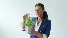 4k Happy Pretty Business woman holding small lovely plant 2 Stock Footage