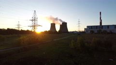 4K UHD Aerial Footage Rising Above Industrial Nuclear Power Plant at Sunrise - stock footage