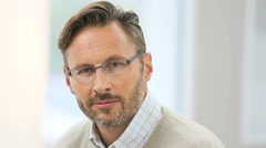 Portrait of confident handsome man with eyeglasses Stock Footage
