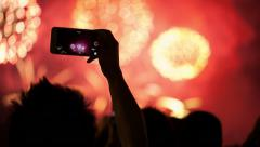 Firework, public, smartphones. Holiday backgrounds. - stock footage