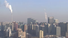 Factory smoke, city skyline, Beijing, China Stock Footage