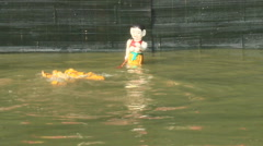Performing water puppetry,Asia - stock footage