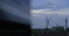 Passenger Train Moves On The Railway Track Close View Railroad Contact Network Stock Footage