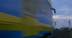 Yellow-Blue Train Moves Fast On The Railway Track Railroad Contact Network Stock Footage