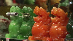 Carved jade figurines holding money, China Stock Footage