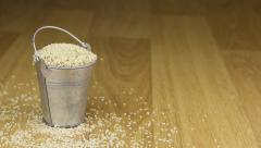 Fall into a bucket of sesame seeds and on wooden floor Stock Footage
