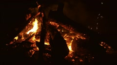 Burning trees in the camp bonfire in the dark. Close up shot. Vietnam. Arkistovideo