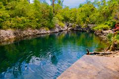 BAY OF PIGS, CUBA - SEPTEMBER 9, 2015:  Tourist attraction for swimming in Cueva Stock Photos