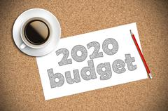 coffee and pencil sketch 2020 budget on paper - stock photo