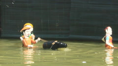 Performing water puppetry, Asia - stock footage