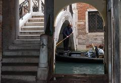 Venetian gondolier from a rare viewpoint - stock photo