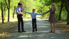 Family walking on the avenue. Stock Footage