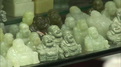 Jade Buddha figurines, Chinese craft market Stock Footage