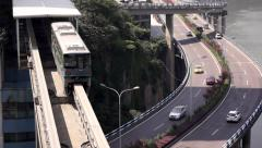 City traffic: light rail train and overpass Stock Footage