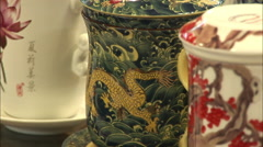Decorative teacups, Beijing craft market - stock footage