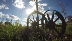 Two old broken wooden horse carriage on  field and sunlight. Timelapse 4K Stock Footage
